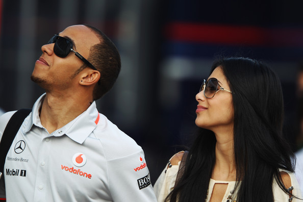 Lewis Hamilton of Great Britain and McLaren Mercedes and his girlfriend Nicole Scherzinger of the Pussycat Dolls walk in the paddock following qualifying for the Turkish Formula One Grand Prix at Istanbul Park on May 29, 2010, in Istanbul, Turkey.