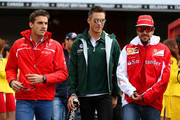 (L-R) Jules Bianchi of France and Marussia, Andre Lotterer of Germany and Caterham and Fernando Alonso of Spain and Ferrari walk out for the drivers' parade before the Belgian Grand Prix at Circuit de Spa-Francorchamps on August 24, 2014 in Spa, Belgium.
