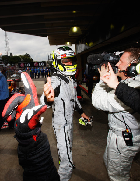 Jenson Button of Great Britain and Brawn GP celebrates in parc ferme after clinching the F1 World Drivers Championship during the Brazilian Formula One Grand Prix at the Interlagos Circuit on October 18, 2009 in Sao Paulo, Brazil.