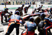 Jaime Alguersuari of Spain and Scuderia Toro Rosso drives in for a pitstop during the Brazilian Formula One Grand Prix at the Autodromo Jose Carlos Pace on November 27, 2011 in Sao Paulo, Brazil.