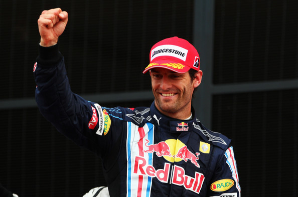 Mark Webber of Australia and Red Bull Racing celebrates on the podium after finishing second during the British Formula One Grand Prix at Silverstone on June 21, 2009 in Northampton, England.