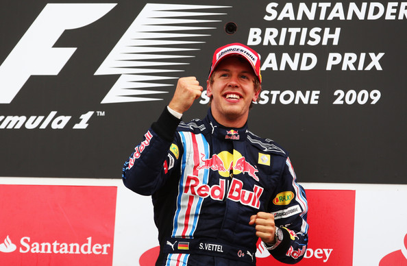 Sebastian Vettel of Germany and Red Bull Racing celebrates on the podium after winning the British Formula One Grand Prix at Silverstone on June 21, 2009 in Northampton, England.