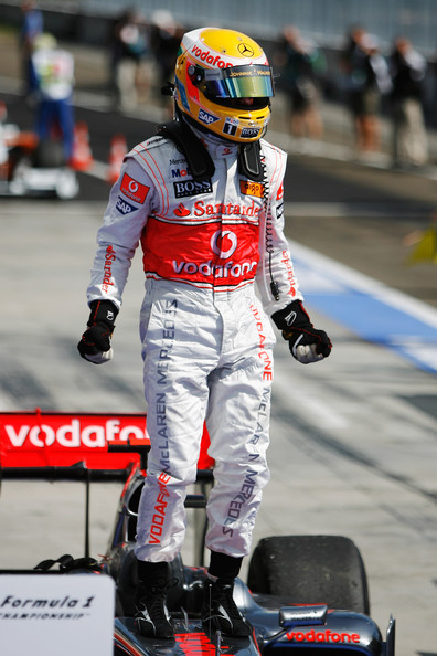 Lewis Hamilton of Great Britain and McLaren Mercedes celebrates in parc ferme after winning the Hungarian Formula One Grand Prix at the Hungaroring on July 26, 2009 in Budapest, Hungary.