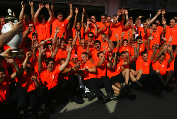 Lewis Hamilton of Great Britain and McLaren Mercedes celebrates in the paddock with team mates after winning the Hungarian Formula One Grand Prix at the Hungaroring on July 26, 2009 in Budapest, Hungary.