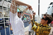 Kris Jenner signs autographs for fans in the Paddock before the Monaco Formula One Grand Prix at Circuit de Monaco on May 27, 2018 in Monte-Carlo, Monaco.