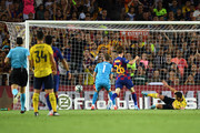 Bernd Leno (1) and Sokratis Papastathopoulos of Arsenal (R) faisl to stop the ball as Ainsley Maitland-Niles of Arsenal scores an own goal for Barcelona's first goal during the Joan Gamper Trophy pre-season friendly match between FC Barcelona and Arsenal at Nou Camp on August 04, 2019 in Barcelona, Spain.