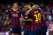 (L-R) Cristian Tello, Daniel Alves and Lionel Messi of FC Barcelona celebrate after his teammate Pedro Rodriguez (not seen) scored his team's seventh goal during the La Liga match between FC Barcelona and CA Osasuna at Camp Nou on March 16, 2014 in Barcelona, Spain.