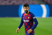 Gerard Pique of FC Barcelona runs with the ball during the Liga match between FC Barcelona and CA Osasuna at Camp Nou on July 16, 2020 in Barcelona, Spain.