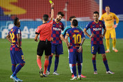 Gerard Pique of FC Barcelona is shown a yellow card by referee Jose Maria Sanchez Martinez during the Liga match between FC Barcelona and CA Osasuna at Camp Nou on July 16, 2020 in Barcelona, Spain.