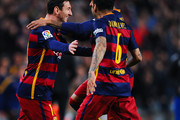 Lionel Messi of FC Barcelona celebrates with his teammates Neymar and Dani Alves of FC Barcelona after scoring the opening goal during the La Liga match between FC Barcelona and Celta Vigo at Camp Nou on February 14, 2016 in Barcelona, Spain.