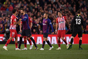 Diego Costa of Atletico Madrid (L)  is restrained by Gerard Pique of Barcelona as he is sent off during the La Liga match between FC Barcelona and  Club Atletico de Madrid at Camp Nou on April 06, 2019 in Barcelona, Spain.