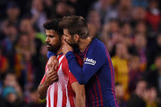 Diego Costa of Atletico Madrid is spoken to by Gerard Pique of Barcelona as he is sent off during the La Liga match between FC Barcelona and  Club Atletico de Madrid at Camp Nou on April 06, 2019 in Barcelona, Spain.