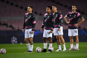(L-R) Aaron Ramsey, Weston McKennie, Cristiano Ronaldo and Leonardo Bonucci of Juventus F.C. look on during their warm up prior to the UEFA Champions League Group G stage match between FC Barcelona and Juventus at Camp Nou on December 08, 2020 in Barcelona, Spain. Sporting stadiums around Spain remain under strict restrictions due to the Coronavirus Pandemic as Government social distancing laws prohibit fans inside venues resulting in games being played behind closed doors.