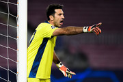 Gianluigi Buffon of Juventus reacts during the UEFA Champions League Group G stage match between FC Barcelona and Juventus at Camp Nou on December 08, 2020 in Barcelona, Spain. Sporting stadiums around Spain remain under strict restrictions due to the Coronavirus Pandemic as Government social distancing laws prohibit fans inside venues resulting in games being played behind closed doors.