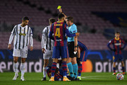Aaron Ramsey of Juventus F.C. is shown a yellow card during the UEFA Champions League Group G stage match between FC Barcelona and Juventus at Camp Nou on December 08, 2020 in Barcelona, Spain. Sporting stadiums around Spain remain under strict restrictions due to the Coronavirus Pandemic as Government social distancing laws prohibit fans inside venues resulting in games being played behind closed doors.