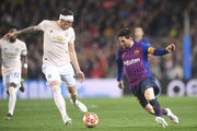 Lionel Messi and Phil Jones Photos - 1 of 13 Photo