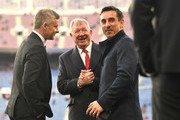Sir Alex Ferguson speaks to Ole Gunnar Solskjaer, Manager of Manchester United and Gary Neville during the UEFA Champions League Quarter Final second leg match between FC Barcelona and Manchester United at Camp Nou on April 16, 2019 in Barcelona, Spain.