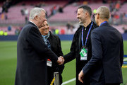 Sir Alex Ferguson shakes hands with Ryan Giggs on the pitch prior to the UEFA Champions League Quarter Final second leg match between FC Barcelona and Manchester United at Camp Nou on April 16, 2019 in Barcelona, Spain.