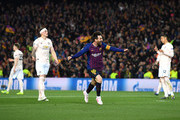 Lionel Messi of Barcelona celebrates after scoring his team's second goal as Phil Jones of Manchester United reacts during the UEFA Champions League Quarter Final second leg match between FC Barcelona and Manchester United at Camp Nou on April 16, 2019 in Barcelona, Spain.