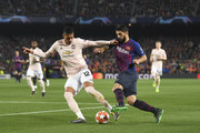 Chris Smalling of Manchester United and Luis Suarez of Barcelona in action during the UEFA Champions League Quarter Final second leg match between FC Barcelona and Manchester United at Camp Nou on April 16, 2019 in Barcelona, Spain.