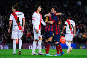Alexis Sanchez of FC Barcelona celebrates with his teammate Lionel Messi after scoring his team's third goal during the La Liga match between FC Barcelona and Rayo Vallecano de Madrid at Camp Nou on February 15, 2014 in Barcelona, Spain.