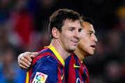 Lionel Messi of FC Barcelona celebrates with his team-mate Alexis Sanchez after scoring his team's fifth goal during the La Liga match between FC Barcelona and Rayo Vallecano de Madrid at Camp Nou on February 15, 2014 in Barcelona, Spain.