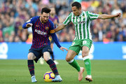 Lionel Messi of Barcelona battles for possession with Andres Guardado of Real Betis during the La Liga match between FC Barcelona and Real Betis Balompie at Camp Nou on November 11, 2018 in Barcelona, Spain.