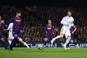 Sergio Ramos of Real Madrid attempts a back heel shot at goal during the Liga match between FC Barcelona and Real Madrid CF at Camp Nou on December 18, 2019 in Barcelona, Spain.