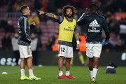 (L-R) Lucas Vazquez, Marcelo Vieira and Vinicius JR of Real Madrid CF in action during the warm up prior to the Copa del Semi Final first leg match between Barcelona and Real Madrid at Nou Camp on February 06, 2019 in Barcelona, Spain.