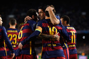 Lionel Messi of Barcelona is congratulated by Luis Suarez and Dani Alves of Barcelona after scoring his teams second goal during the UEFA Champions League Group E match between FC Barcelona and AS Roma at Camp Nou on November 24, 2015 in Barcelona, Spain.