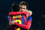 Neymar (R) of FC Barcelona celebrates with his teammate Alexis Sanchez of FC Barcelona after scoring his team's second goal during the La Liga match between FC Barcelona and Villarreal CF at Camp Nou on December 14, 2013 in Barcelona, Spain.
