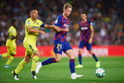 Frenkie De Jong of FC Barcelona conducts the ball under pressure from Santi Cazorla of Villarreal CF during the Liga match between FC Barcelona and Villarreal CF at Camp Nou on September 24, 2019 in Barcelona, Spain.
