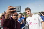 Thomas Mueller poses for selfies after a training session on day 2 of the FC Bayern Muenchen training camp at ASPIRE Academy for Sports Excellence on January 3, 2018 in Doha, Qatar.