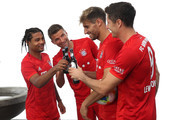 (L-R) Serge Gnabry, Thomas Mueller, Javier Martinez and Robert Lewandowski of FC Bayern Muenchen during the FC Bayern Muenchen and Paulaner photo session at FGV Schmidtle Studios on September 01, 2019 in Munich, Germany.