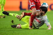Thomas Muller #25 of Bayern Munich clashes with Salih Oezcan #20 of 1.FC Koeln during the Bundesliga match between FC Bayern Muenchen and 1. FC Koeln at Allianz Arena on December 13, 2017 in Munich, Germany.