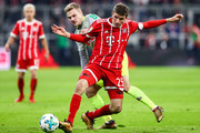 Thomas Muller #25 of Bayern Munich (R) and Tim Handwerker #29 of 1.FC Koeln battle for the ball during the Bundesliga match between FC Bayern Muenchen and 1. FC Koeln at Allianz Arena on December 13, 2017 in Munich, Germany.