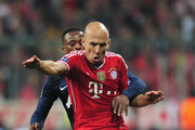 Arjen Robben of Bayern Muenchen is tackled by Patrice Evra of Manchester United during the UEFA Champions League Quarter Final second leg match between FC Bayern Muenchen and Manchester United at Allianz Arena on April 9, 2014 in Munich, Germany.
