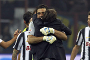 Antonio Conte manager of Juventus FC celebrates a victory with Gianluigi Buffon at the end of the Serie A match between FC Internazionale Milano and Juventus FC at Stadio Giuseppe Meazza on October 29, 2011 in Milan, Italy.