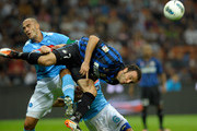 Giampaolo Pazzini of FC Inter Milan and Paolo Cannavaro of SSC Napoli compete during the Serie A match between FC Internazionale Milano and SSC Napoli at Stadio Giuseppe Meazza on October 1, 2011 in Milan, Italy.