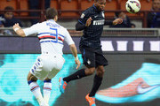 Joel Obi (R) of Inter competes for the ball with Djamel Mesbah of Sampdoria during the Serie A match between FC Internazionale Milano and UC Sampdoria at Stadio Giuseppe Meazza on October 29, 2014 in Milan, Italy.