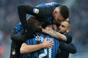 Ivan Perisic of FC Internazionale Milano (C) celebrates with his team-mate Davide Santon, Mauro Emanuel Icardi and Marcelo Brozovic after scoring the opening goal during the Serie A match between FC Internazionale and AC Chievo Verona at Stadio Giuseppe Meazza on December 3, 2017 in Milan, Italy.