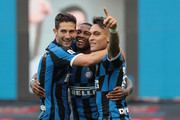Ashley Young (C) of FC Internazionale celebrates after scoring the opening goal with teammates Lautaro Martinez (R) and Roberto Gagliardini (L) during the Serie A match between FC Internazionale and Brescia Calcio at Stadio Giuseppe Meazza on July 1, 2020 in Milan, Italy.