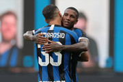 Danilo D Ambrosio of FC Internazionale celebrates his goal with his team-mate Ashley Young during the Serie A match between FC Internazionale and Brescia Calcio at Stadio Giuseppe Meazza on July 1, 2020 in Milan, Italy.