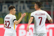 Stephan El Shaarawy of AS Roma (L) celebrates with his team-mate Lorenzo Pellegrini after scoring the opening goal during the Serie A match between FC Internazionale and AS Roma at Stadio Giuseppe Meazza on January 21, 2018 in Milan, Italy.