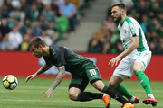 Fyodor Smolov (L) of FC Krasnodar vies for the ball with Vladimir Granat of FC Rubin Kazan during the Russian Premier League match between FC Krasnodar v FC Rubin Kazan at Krasnodar Stadium on May 13, 2018 in Krasnodar, Russia.