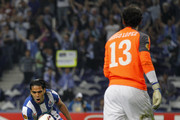 Radamel Falcao of FC Porto celebrates in front of Diego Lopez of Villarreal after scoring his side equalizer goal during the UEFA Europa League semi final first leg match between FC Porto and Villarreal at Estadio do Dragao on April 28, 2011 in Porto, Portugal.