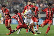 Renato of Kawasaki Frontale compete for the ball with Kim Chi-Woo and Kim Ju-Young of FC Seoul during the AFC Champions League Round of 16 match between FC Seoul and Kawasaki Frontale at Seoul World Cup Stadium on May 14, 2014 in Seoul, South Korea.