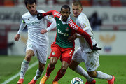 Maicon (C) of FC Lokomotiv Moscow is challenged by Oleg Ivanov and Rizvan Utsiev of FC Terek Grozny during the Russian Premier League match between FC Lokomotiv Moscow and FC Terek Grozny at Lokomotiv Stadium on October 18, 2014 in Moscow, Russia.