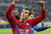 Vlad Chiriches of FC Steaua celebrates their win after the UEFA Europa League Round of 16 match between FC Steaua Bucuresti and Chelsea at the National Arena on March 7, 2013 in Bucharest, Romania.