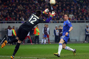 Fernando Torres of Chelsea watches the cross go by as goalkeeper of FC Steaua, Cipeian Tatarusanu catches during the UEFA Europa League Round of 16 match between FC Steaua Bucuresti and Chelsea at the National Arena on March 7, 2013 in Bucharest, Romania.